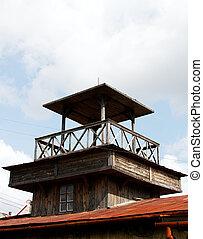 Watchtower. - Wooden watchtower against blue sky.
