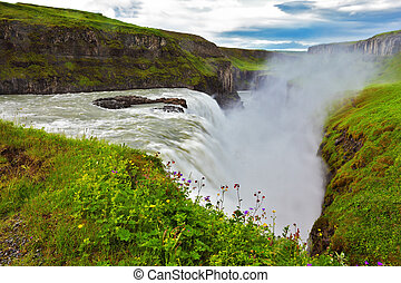 Water abyss. Scenic Gullfoss in Iceland. Over boiling water ...