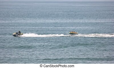 Tourists ride on an inflatable sliding. - Water activities....