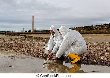 Water Analysis - Experts analyze the water in a contaminated...