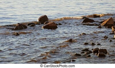 Water and rocks. Waves on the shore of the Gulf of Finland