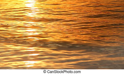 water at sunset - close-up water in orange colours at sunset...