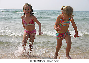 water babies - little girls playing at the beach