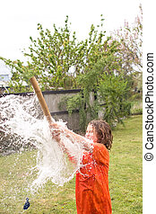 Water Balloon Fun 04 - A young male playing with water ...