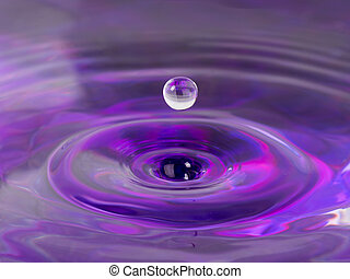 water balloon - lilac water and formed a ball thrown by a...