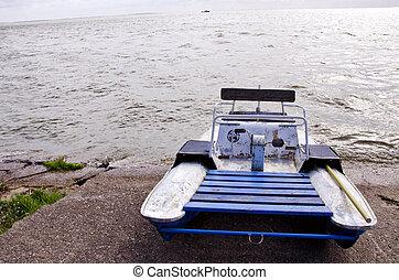 water bike catamaran on lake concrete pier ship