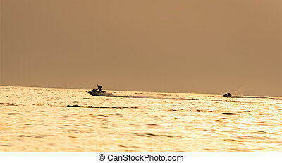 water bikers at the sunset