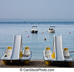 Water bikes on the beach in the morning