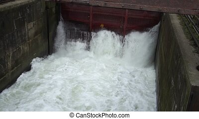 Water boils at the dam hydroelectric power plant