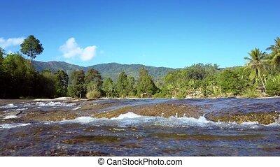 water boils on rapids against pictorial landscape - river...