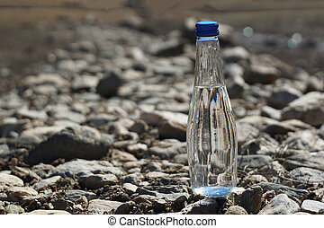 Water bottle on a stone background