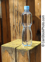 Water bottle on a wooden background