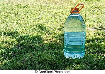 Water bottle on green grass