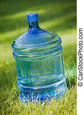 water bottle on green lawn background
