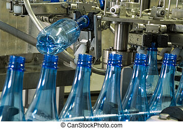 Water bottle production machine - Plastic water bottles on...