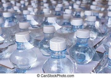 Water bottles in plastic wrap
