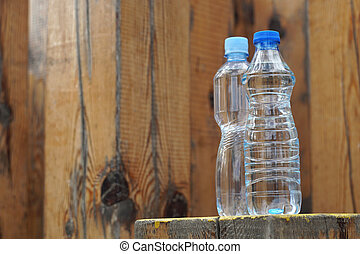 Water bottles on a wooden background
