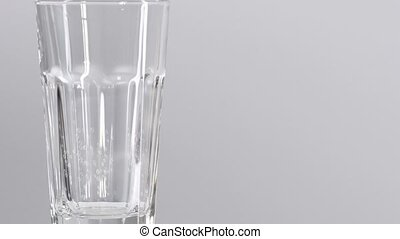 Water glass isolated on white background with small bubbles.