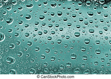 Water bubbles on a green glass. Abstract background