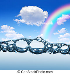 Water bubbles with rainbow and blue sky