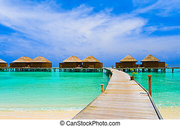 Water bungalows and pathway - Water bungalows at a tropical...