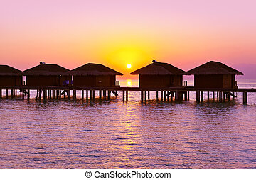 Water bungalows on Maldives island - nature travel...