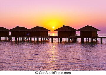Water bungalows on Maldives island - nature travel...