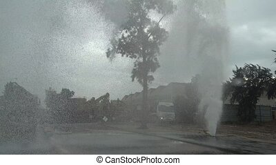 Water burst as a result of ruptured water pipeline on the road