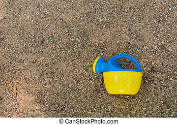 Water can in the sand 1