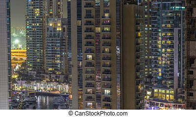 Water canal on Dubai Marina skyline at night timelapse. -...