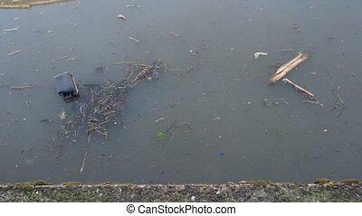 Pollution in a water canal with floating litter