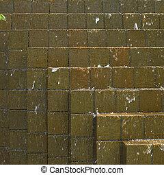 Water cascading down on bricks