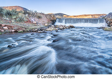 water cascading over a dam