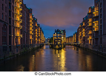 Water castle in old Speicherstadt or Warehouse district,...