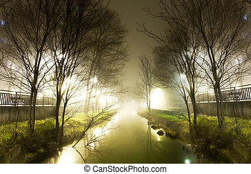 Water channel at night - City scenery.Water channel and...