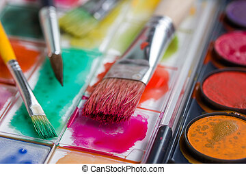 water color box with paint brushes