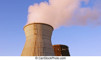 Water cooling tower stack smoke over blue sky background. Energy generation and air environment pollution industrial scene. 4K UHD video footage.