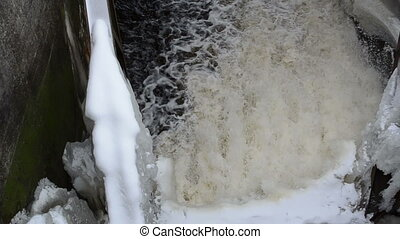 water dam ice winter - panorama of strong water current flow...