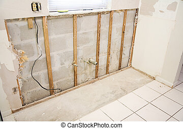 Water Damage in Kitchen - Interior of kitchen with drywall ...