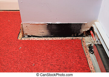 water damage - a water damaged wall from leaking pipe with...