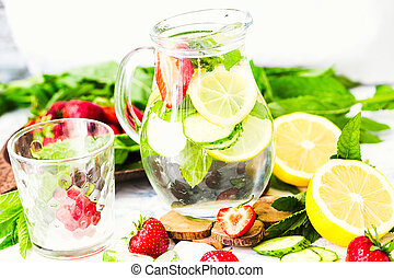 water-detox with lemon, strawberries and mint on light background