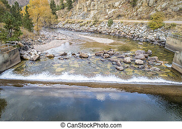 Cache la Poudre River and water diversion dam in a canyon above Fort Collins, Colorado - aerial view with fall scenery