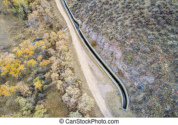 water diversion ditch (Charles Hansen Canal) at foothills above Fort Collins, Colorado - aerial view with fall scenery