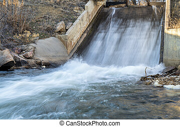 water diversion in northern Colorado - a dam and water inlet to a reservoir
