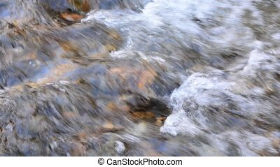 Water down the river - Detail of water down a river in...