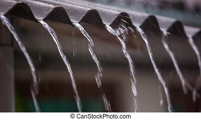 Water drains from the roof shower. Slow motion. - water...