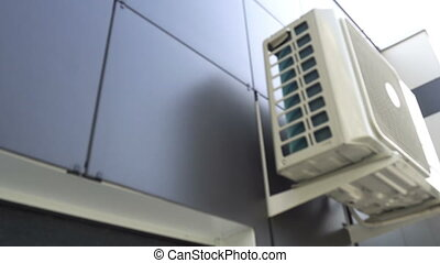 Water dripping from air conditioner.