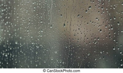 Water Droplets Fall Down - Close up waterdrops on the window...