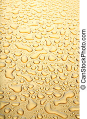 water droplets gold background