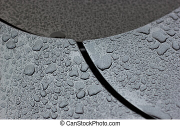 Water droplets on car black surface